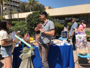 Religious Studies professor William Elison speaking to a student at Spring Insight 2018.